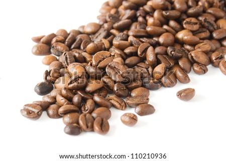 Coffee beans handful closeup isolated on white background - stock photo