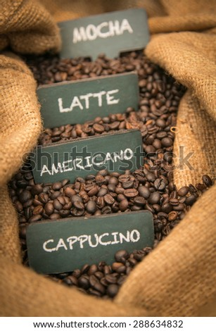 Coffee Beans in a Bag with coffee's label - stock photo