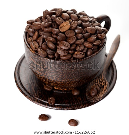 Coffee beans in a cup on a white background