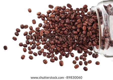 Coffee beans in a glass jar on white background - stock photo
