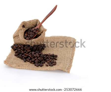 Coffee Beans in a sack Bag. This has clipping path.  - stock photo