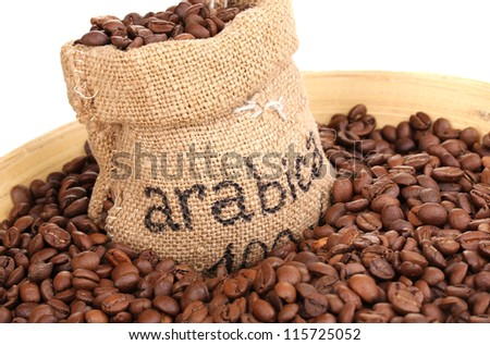 Coffee beans in bag and bowl close-up - stock photo