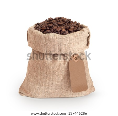 Coffee beans in burlap sack with blank tag - stock photo