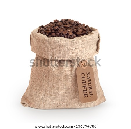 Coffee beans in burlap sack with tag - stock photo