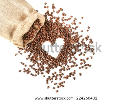 Coffee beans in coffee bag made from burlap on wooden surface. Heart shape made from coffee beans - stock photo
