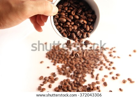 Coffee beans in coffee cup - stock photo