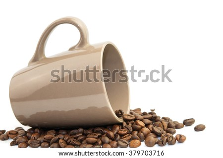 Coffee beans in coffee cup isolated on white - stock photo
