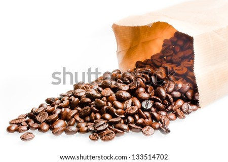 coffee beans in coffee cup on white background - stock photo