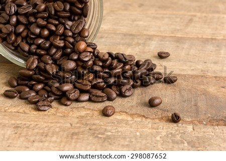 coffee beans in glass bottle