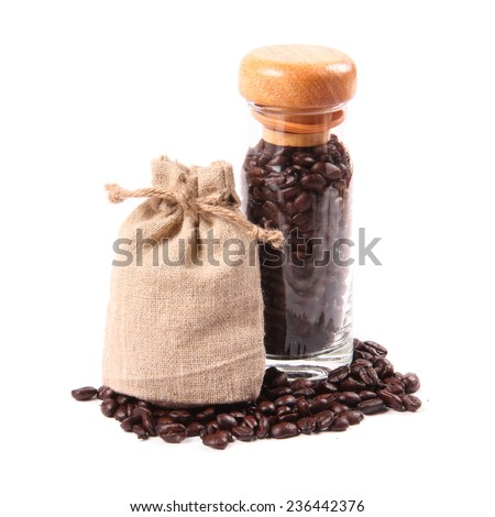 Coffee beans in glass bottle and bag - stock photo