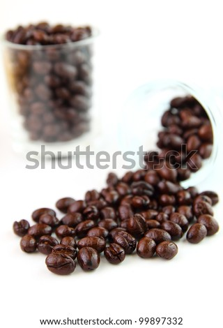 Coffee beans in glasses on white background
