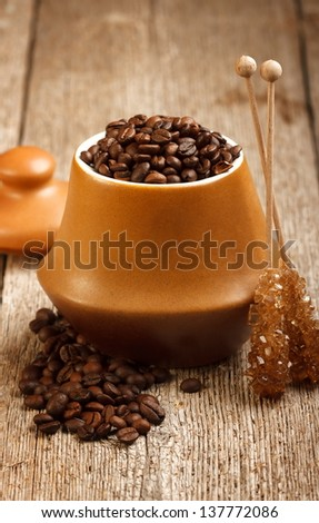 Coffee beans in vintage ceramic dish