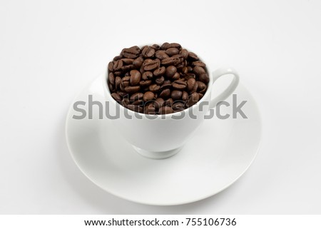 Coffee beans in white glass, white background