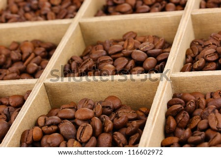 Coffee beans in wooden box close-up - stock photo