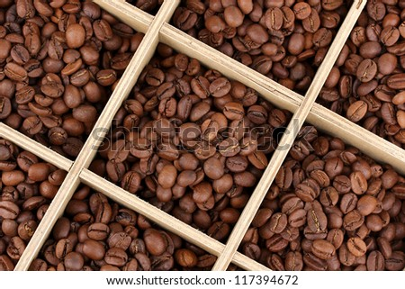 Coffee beans in wooden box close-up