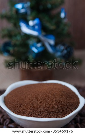 Coffee beans, instant coffee and decorative Christmas tree  - stock photo