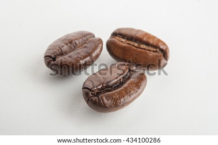 coffee beans isolated on white background. Three coffee beans