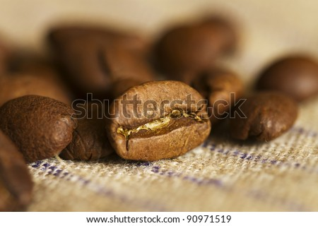 coffee beans lying on rough fabric
