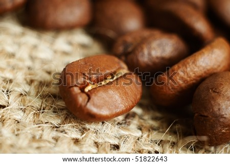 Coffee beans macro on sack background - stock photo