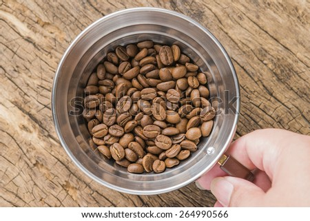 Coffee beans of arabica on texture wooden background. - stock photo