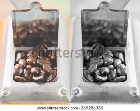 Coffee beans of arabica on texture wooden background. Photo in vintage color tone style. - stock photo