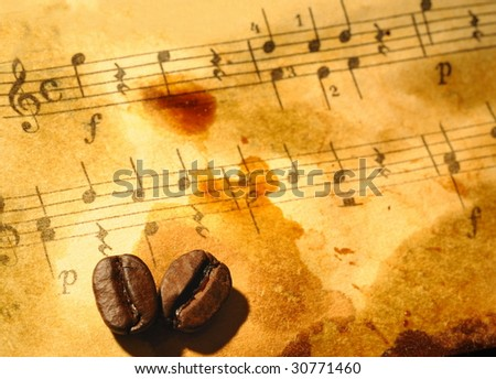 Coffee beans on a grungy musical background - stock photo