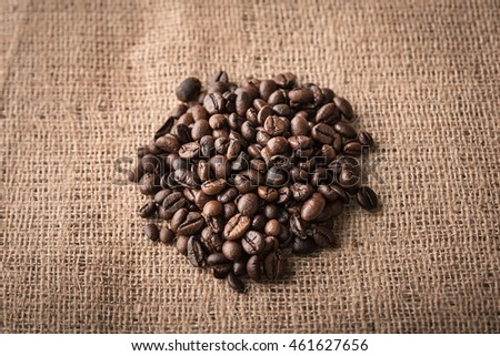 Coffee beans on a sackcloth background