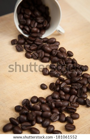 Coffee beans on a wood plank