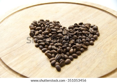 Coffee beans on a wooden board - stock photo