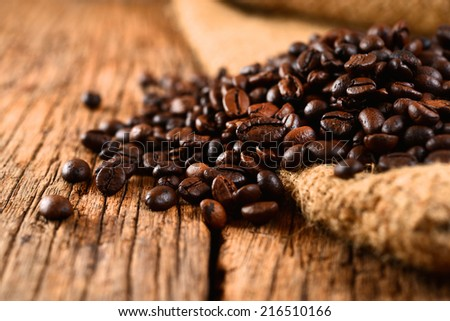 Coffee beans on burlap bag - stock photo