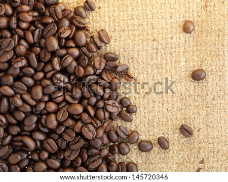 coffee beans on canvas background - stock photo