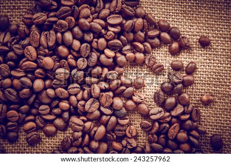 Coffee beans on linen background - stock photo