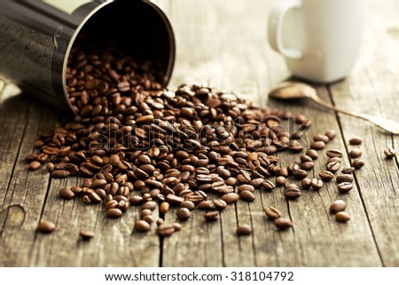 coffee beans on old a wooden table - stock photo