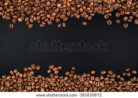 coffee beans on rustic slate background - stock photo