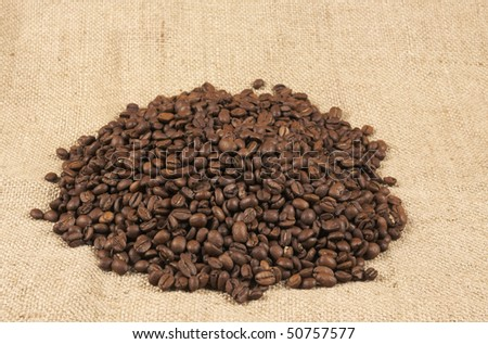 coffee beans on the background of the sacking - stock photo