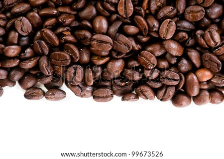 Coffee beans on the white background with copy space - stock photo