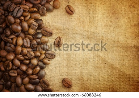 Coffee beans on vintage background - stock photo