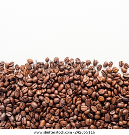 Coffee beans on white background with area for copy space. - stock photo