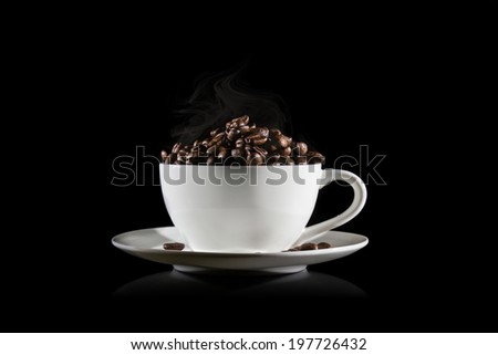 coffee beans on white cup with smoke isolated on black background. - stock photo
