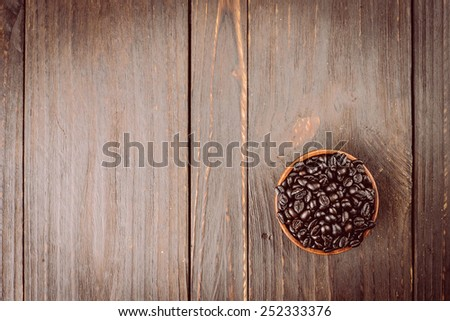 Coffee beans on wooden background - vintage effect style pictures - stock photo