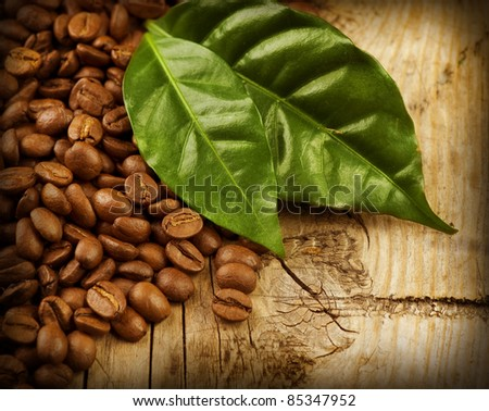 Coffee Beans over Wood Background - stock photo