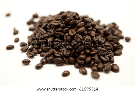 Coffee beans pile isolated - stock photo