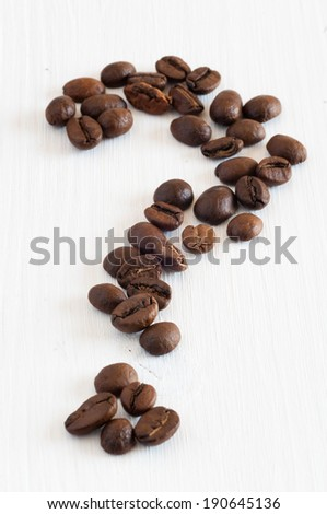coffee beans shaped as a question mark, is this fair trade coffee - stock photo