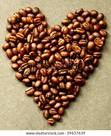 Coffee beans shaped into a heart.
