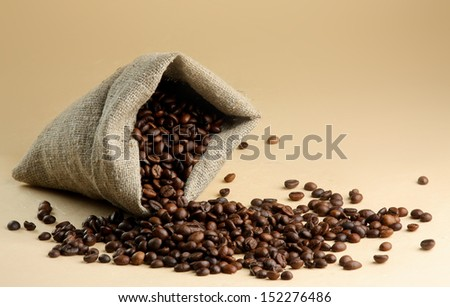 Coffee beans spilled out of the bag - stock photo