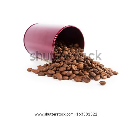 Coffee beans spilling out from a red can. - stock photo