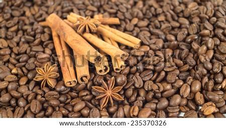 Coffee beans. Three anise stars. Lots of sticks of cinnamon. Shallow depth of field. Pattern. - stock photo