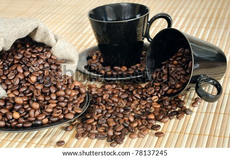 coffee beans with black cups and sack - stock photo
