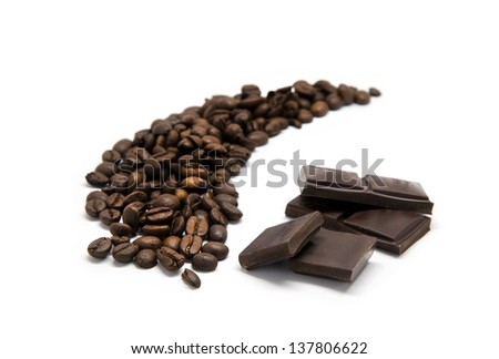 Coffee beans with chocolate isolated - stock photo