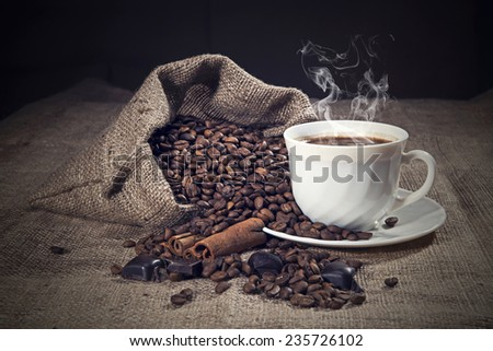 Coffee beans with coffee cup - stock photo
